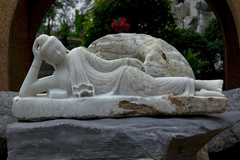 Statues carved from marble in Chinese style are unique. The statue was carved from marble in the form of China is unique stock photography