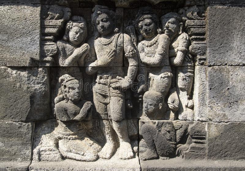 Statues carved in stone. Detail of carved relief at Borobudur on Java, Indonesia royalty free stock photography