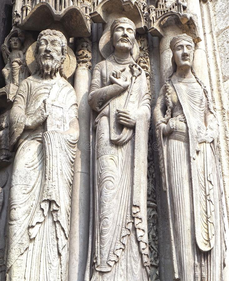Statues of Catholic Saints at Cathedrale Notre Dame de Chartres, a medieval old Catholic cathedral in Chartres, France.  royalty free stock photo