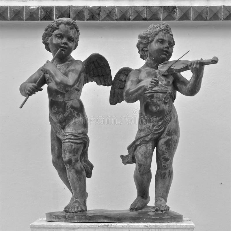 Statues of cherub musicians royalty free stock images