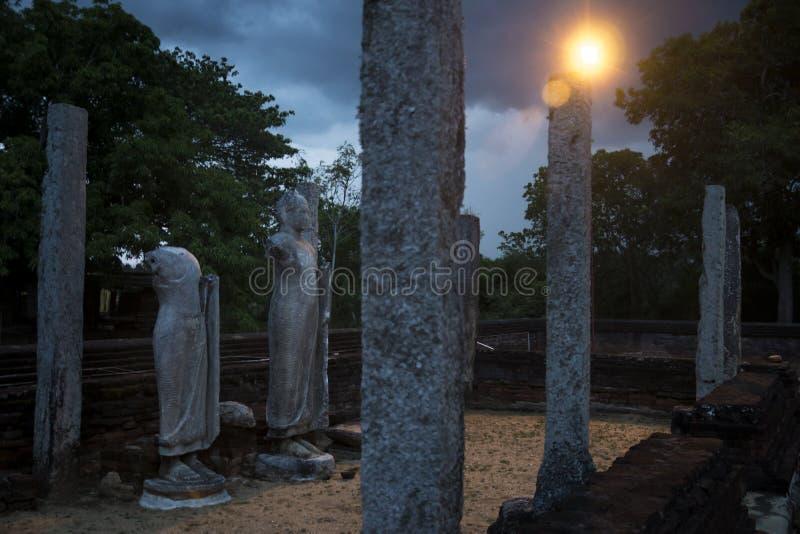 Statues and columns at night, Yatala Wehera, Tissamaharama, Sri. Statues and columns at night stock photography