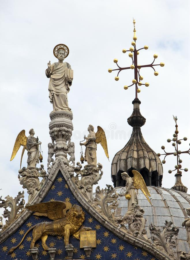 statues and crosses decorate the rooftop of the Basilica di San Marco Saint Mark Basilica in Venice, Italy royalty free stock photography