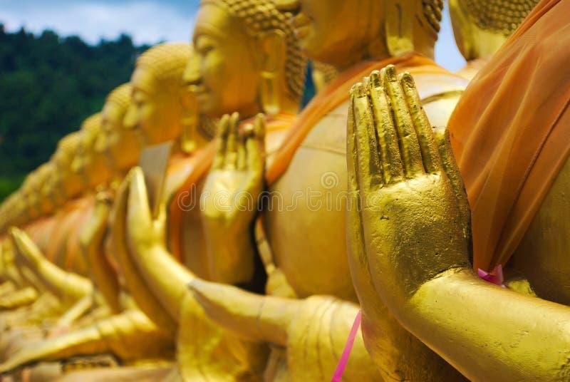 Statues d'or de Bouddha image stock