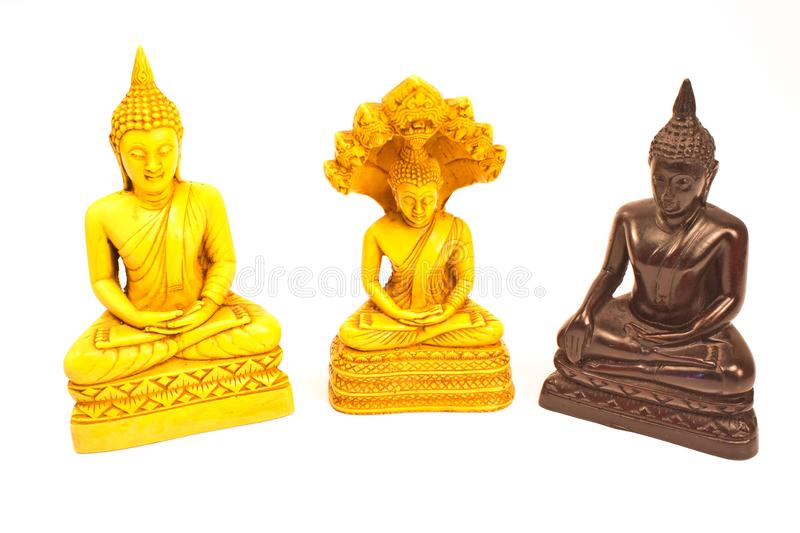 Statues de Bouddha d'isolement sur le blanc photos stock