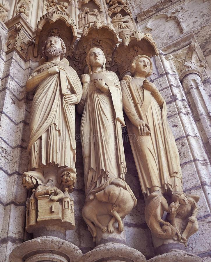 Statues details at Cathedrale Notre Dame de Chartres, a medieval old Catholic cathedral in Chartres, France.  stock images