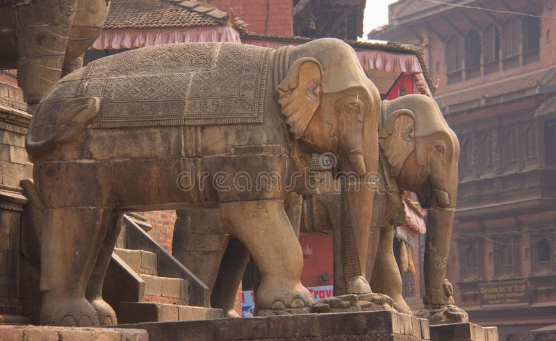 Statues of Elephants In Front of Temple in Kathmandu. Two elephant statues in front of a temple in Kathmandu, Nepal stock images