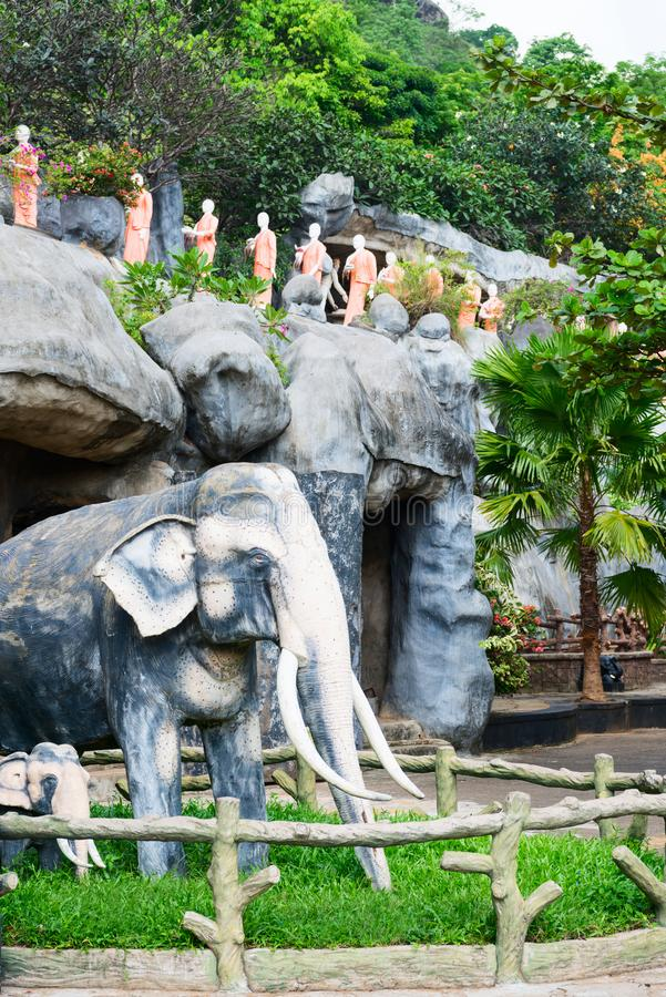 Statues of elephants and monks in Golden cave temple in Dambulla, Sri Lanka. Statues of elephants and monks on a rock in Golden cave temple in Dambulla, Sri royalty free stock photo
