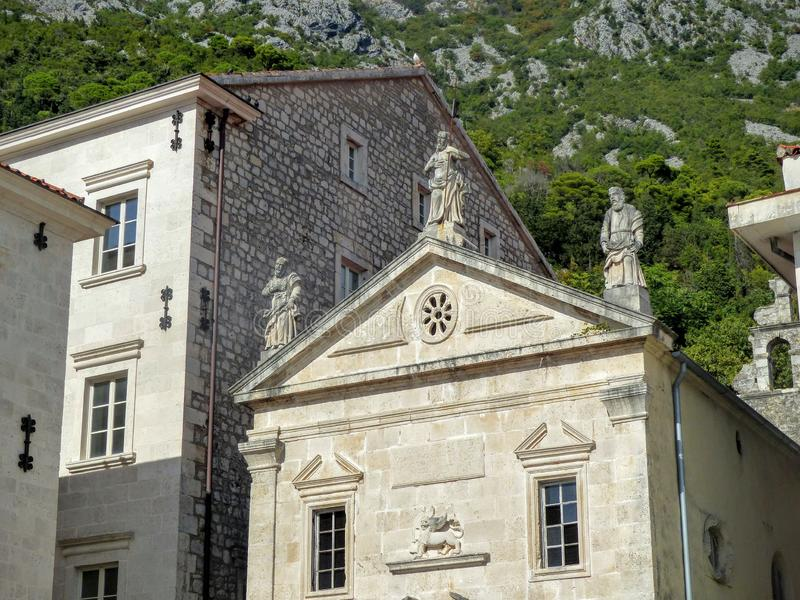 Statues of the end of the church of Saint Marc at Perast in Montenegro. royalty free stock photos