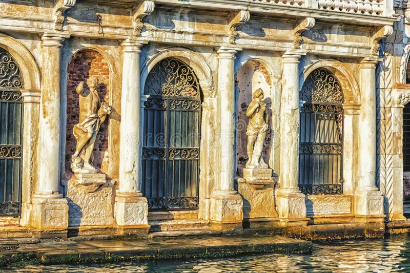 Statues on the facade of Giusti Palace on the Grand Canal of Venice, Italy.  royalty free stock image