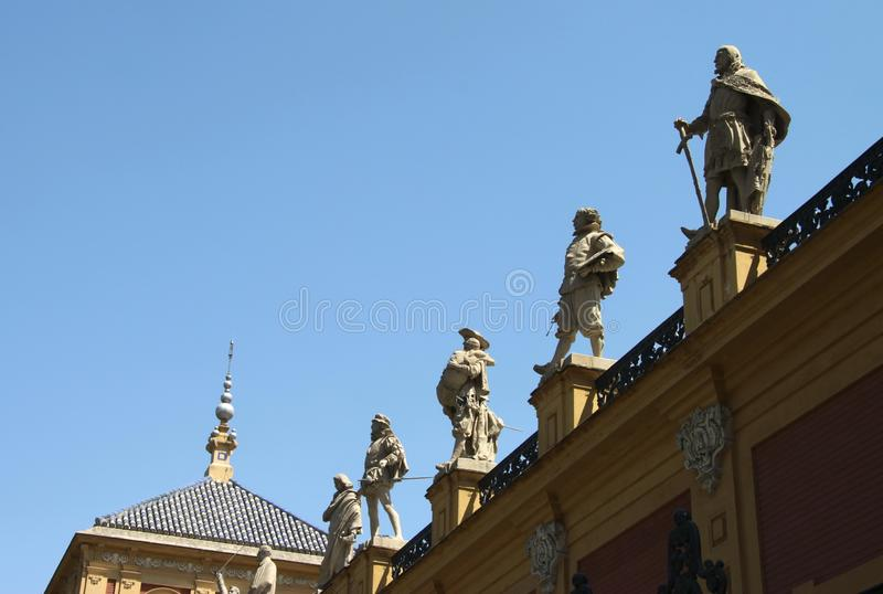 Statues of famous citizens of the city on the facade of the Palacio de San Telmo Palace in Seville. SEVILLE, SPAIN - JULY 15, 2011: Statues of famous citizens of royalty free stock image