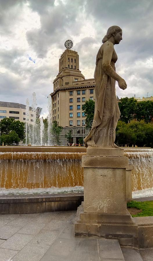 Statues, fountains and landmarks Plaça Catalunya. The Plaça Catalunya square in Barcelona with it`s popular fountains accompanied by mythologic statues and stock photos