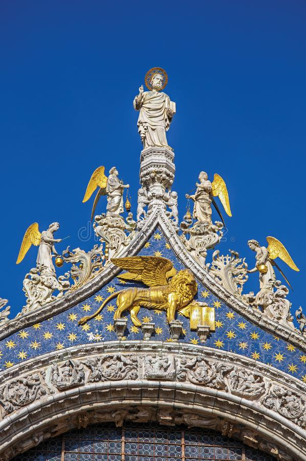 Statues and frontispiece made in marble and gold in Venice stock images