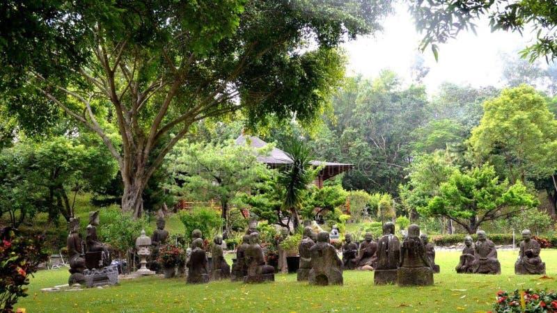 Statues in garden stock photo