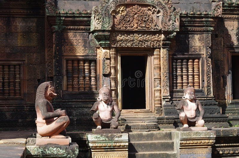 Statues guard of Banteay Srei temple stock images