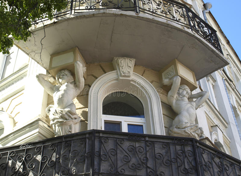 Statues holding a balcony. Architecture of Kiev Ukraine. Statues supporting the balcony in one of the old buildings royalty free stock image