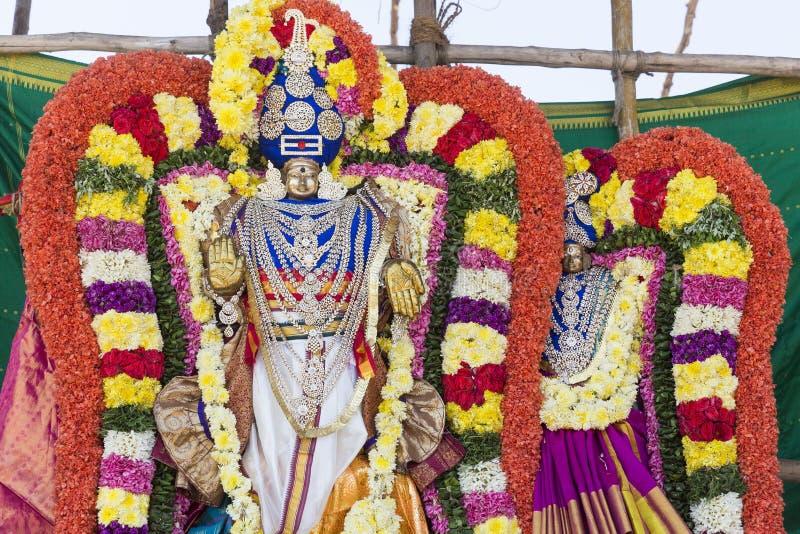 Statues of the Indian gods. Brahma, Vishnu Durga Shiva Ganesha, made with flowers for the the Masi Magam festival. Puduchery, Tamil Nadu, India stock images