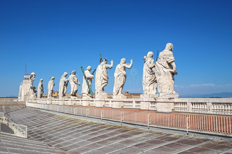 Statues of Jesus Christ, John the Baptist and 11 apostles on the roof of St. Peter`s Cathedral stock photo