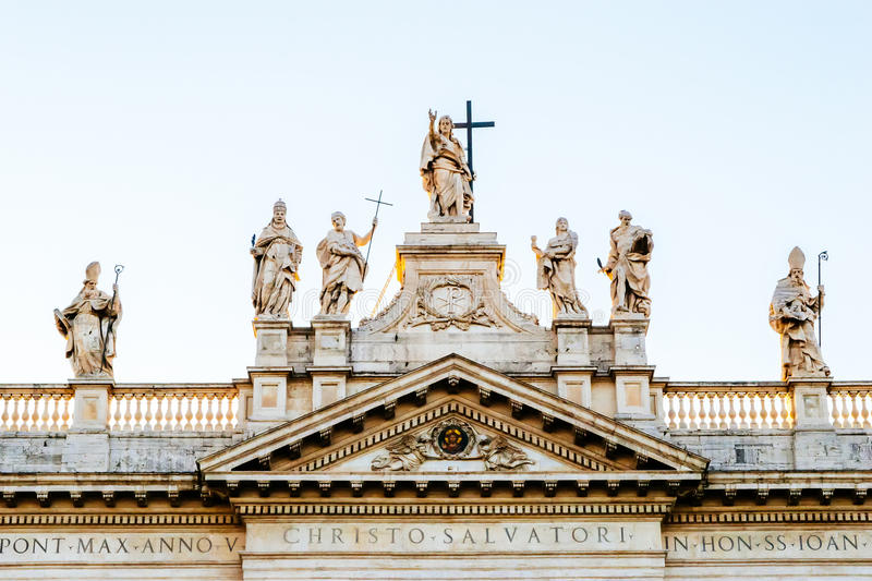 Statues of Jesus Christ and the various saints on top of the fac royalty free stock images