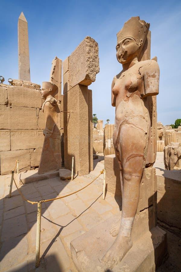 Statues in Karnak Temple. Luxor, Egypt. Amun Re and Amunet Dyad statue. Karnak Temple, Luxor, Egypt royalty free stock photos