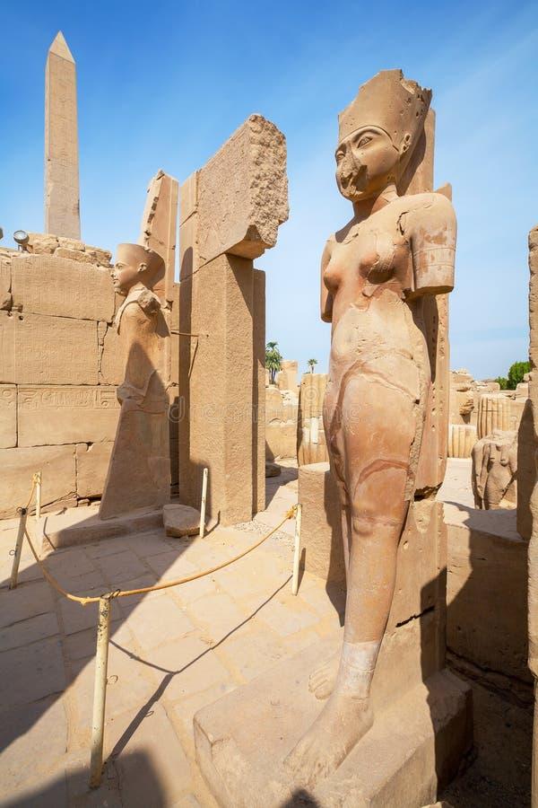 Statues in Karnak Temple. Luxor, Egypt. Amunet Dyad and Amun Re statues. Karnak Temple, Luxor, Egypt stock photo