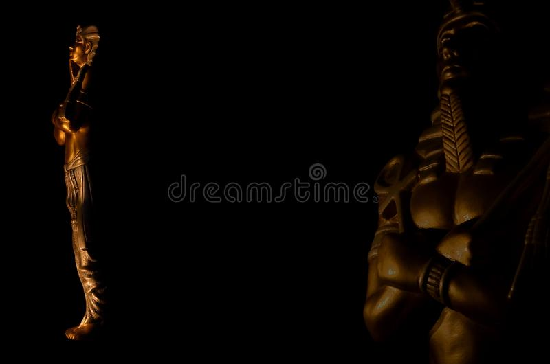 Statues of king egyptian pharaoh gods dead religion symbol isolated on black background. Statues of king pharaoh gods dead religion symbol isolated on black royalty free stock photo