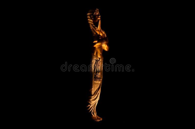 Statues of king egyptian pharaoh gods dead religion symbol isolated on black background. Statues of king pharaoh gods dead religion symbol isolated on black stock image