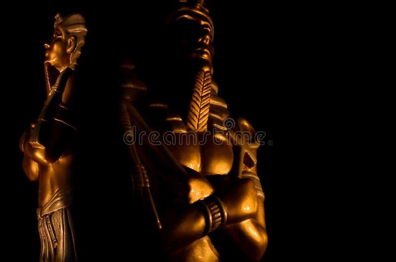 Statues of king egyptian pharaoh gods dead religion symbol isolated on black background. Statues of king pharaoh gods dead religion symbol isolated on black royalty free stock photography