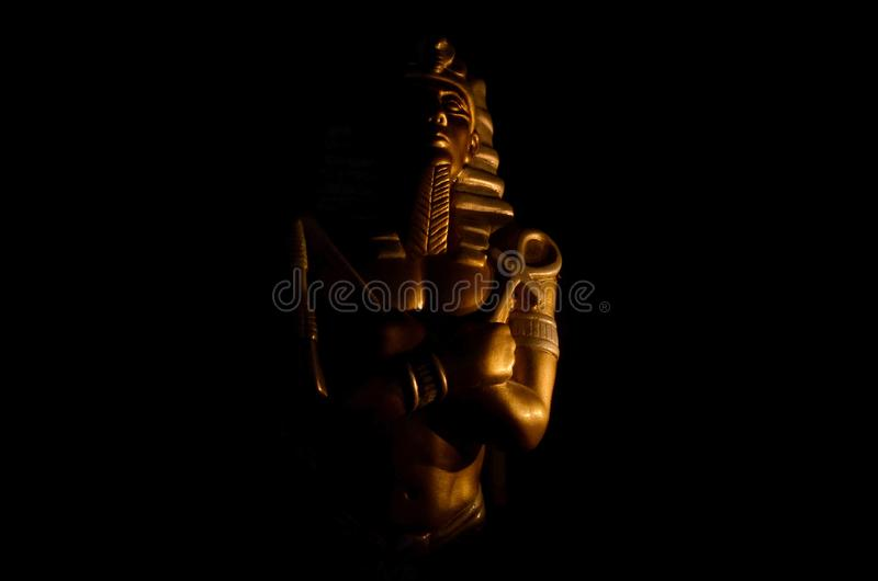 Statues of king egyptian pharaoh gods dead religion symbol isolated on black background. Statues of king pharaoh gods dead religion symbol isolated on black stock images