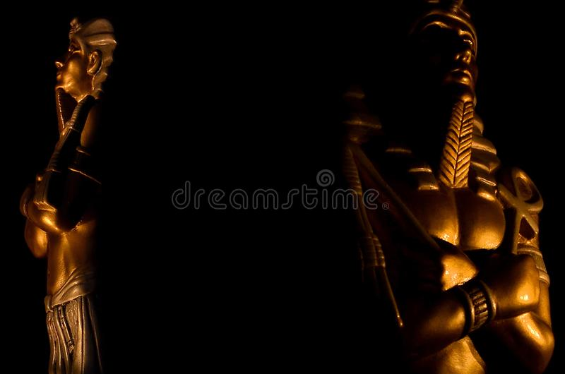 Statues of king egyptian pharaoh gods dead religion symbol isolated on black background. Statues of king pharaoh gods dead religion symbol isolated on black royalty free stock images