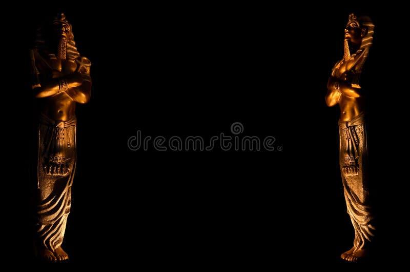 Statues of king egyptian pharaoh gods dead religion symbol isolated on black background. Statues of king pharaoh gods dead religion symbol isolated on black royalty free stock image