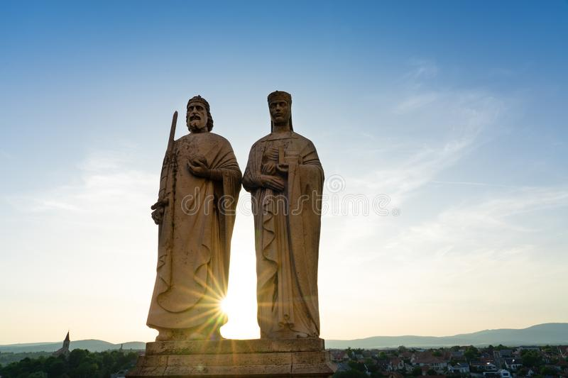 Statues of King Stephen I of Hungary and his wife Gisela over the Castle Hill of Veszprem town royalty free stock photo