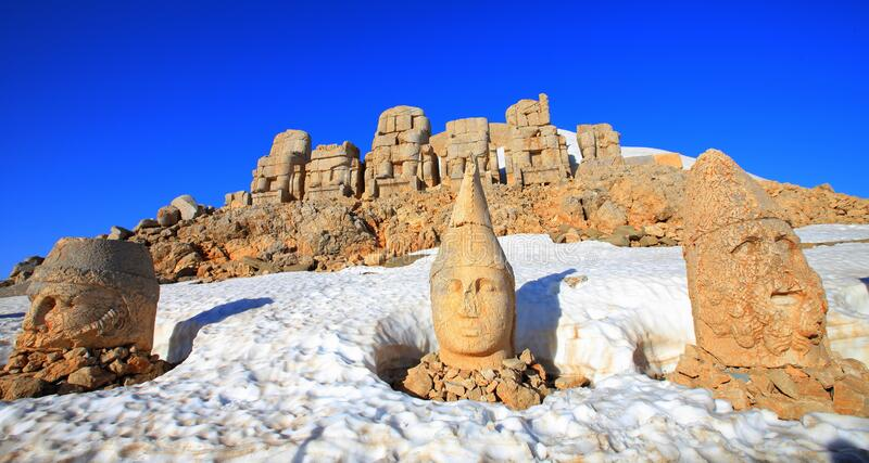 Mount Nemrut. The statues of the Kingdom of Komagene on the Mount Nemrut in the Adiyaman are the focus of the tour. These syatues are on the unesco list stock photo