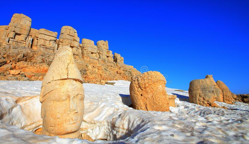 Mount Nemrut. The statues of the Kingdom of Komagene on the Mount Nemrut in the Adiyaman are the focus of the tour. These syatues are on the unesco list royalty free stock image