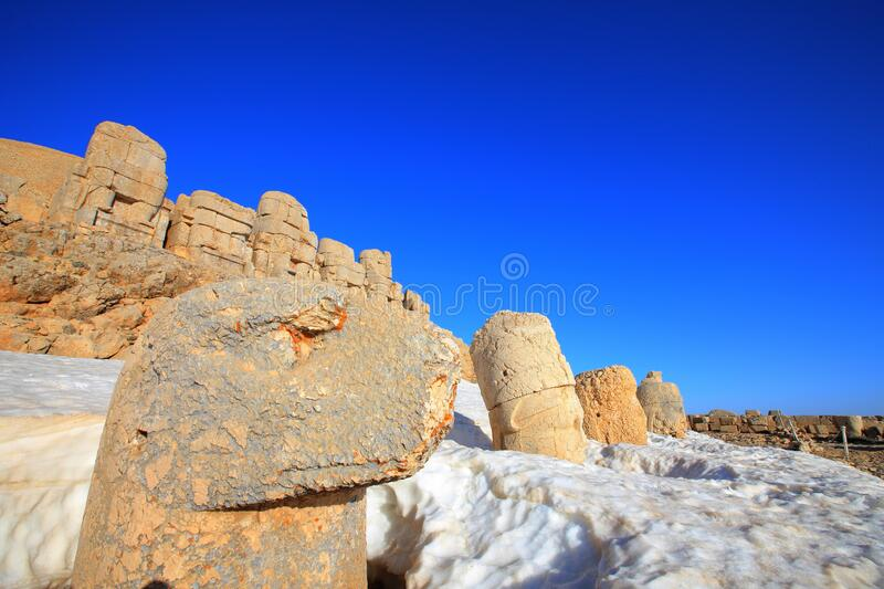 Mount Nemrut. The statues of the Kingdom of Komagene on the Mount Nemrut in the Adiyaman are the focus of the tour. These syatues are on the unesco list royalty free stock photo