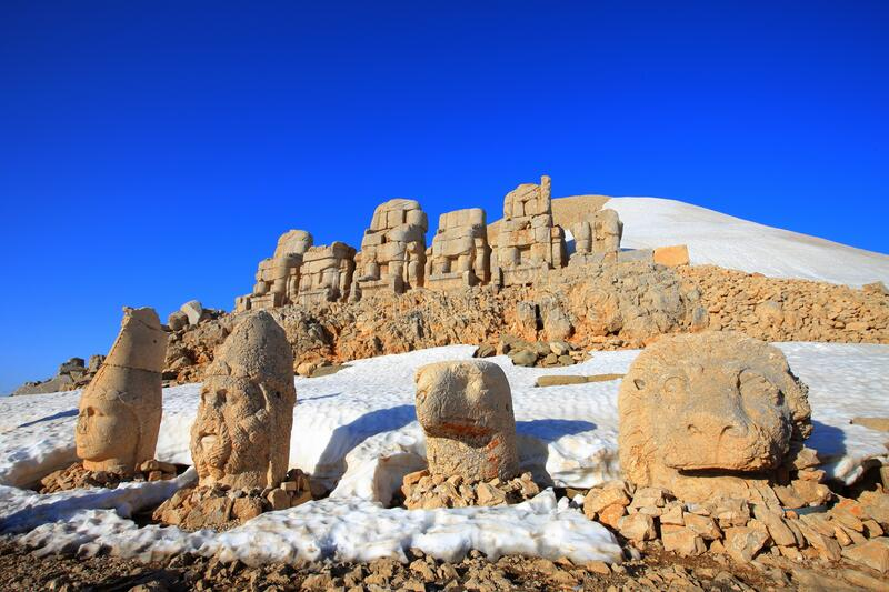 Mount Nemrut. The statues of the Kingdom of Komagene on the Mount Nemrut in the Adiyaman are the focus of the tour. These syatues are on the unesco list stock photography