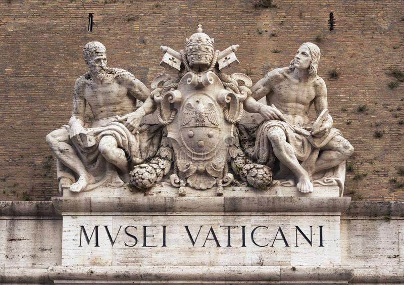 Statues of Michelangelo and Raphael over the Vatican museums entrance. Rome, Italy stock images