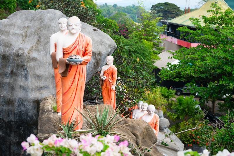 Statues of monks in Golden cave temple in Dambulla, Sri Lanka royalty free stock photo