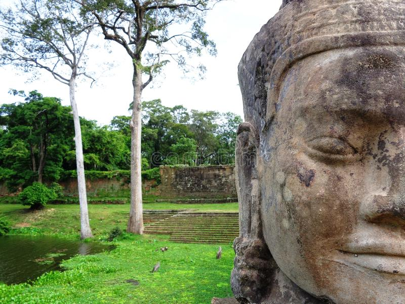 The statues and the nature of Angkor Wat royalty free stock photos