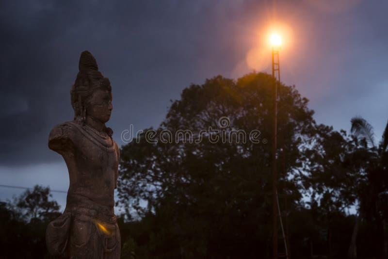 Statues at night, Yatala Wehera, Tissamaharama, Sri Lanka. Statue at temple lightned at night royalty free stock images