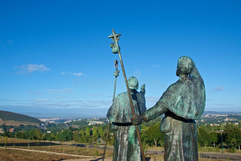 Statues of Pilgrims pointing the cathedral on Monte do Gozo in Santiago de Compostela, Spain. Europe royalty free stock image
