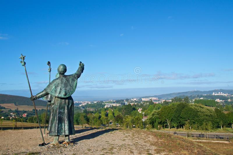 Statues of Pilgrims pointing the cathedral on Monte do Gozo in Santiago de Compostela, Spain royalty free stock images
