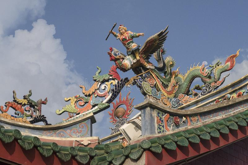 Statues on the roof of a chinese temple in the streets of Kuching of Malaysia. Colorful statues on the roof of a chinese temple in the streets of Kuching of royalty free stock photos