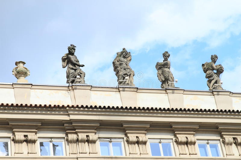 Statues on roof stock images