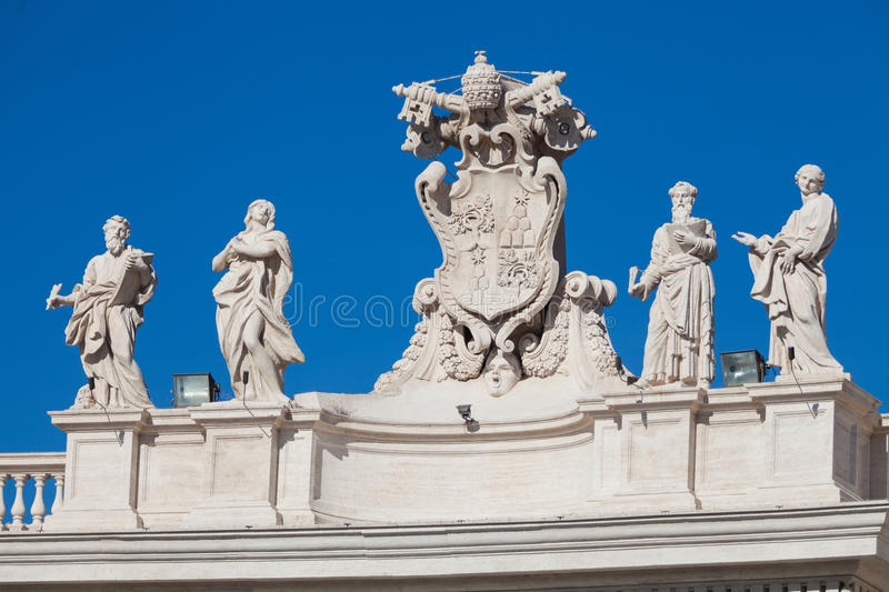 Statues on the roof of the Vatican in Rome. Saint Peter royalty free stock photo