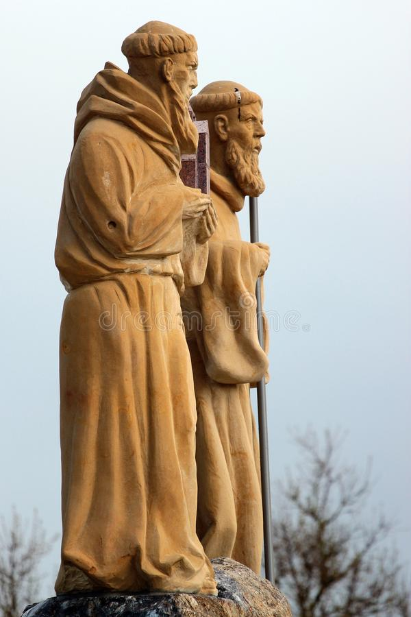 Statues of Saint Roch and Saint Romuald in Suwalki, Poland. Suwalki, Poland - May 3, 2019: Statues of Saint Roch and Saint Romuald, the patrons of Suwalki town royalty free stock photo