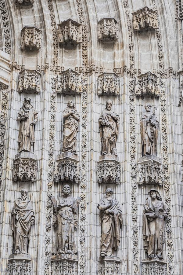Statues of saints carved in stone, detail of exterior in the Cathedral of Seville, Andalusia, Spain. Sevilla, SPAIN - september, 9: Statues of saints carved in royalty free stock photo