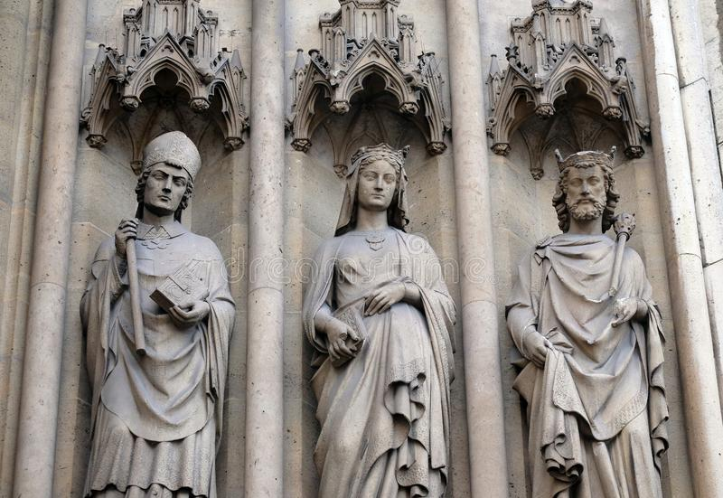 Statues of Saints on the portal of the Basilica of Saint Clotilde in Paris, France stock images