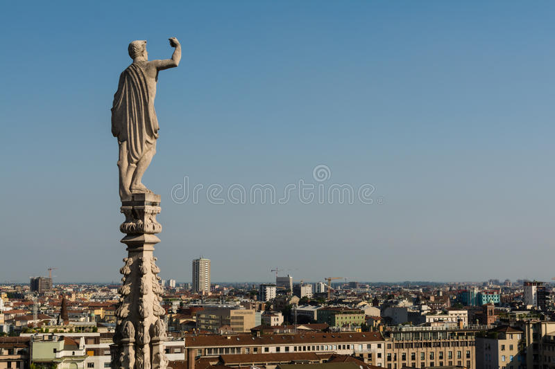 Statues on steeples at the roof of Il Duomo di Milano. stock image