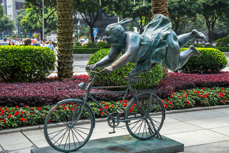 Statues on the streets of Guangzhou Pearl River new town commercial center stock images