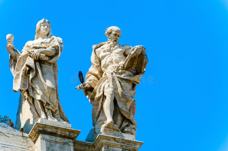 Statues at the top of Basilica of Saint John Lateran in Rome, It royalty free stock photography